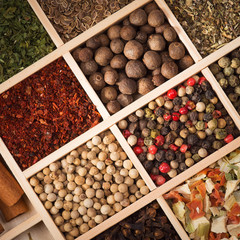 Set of spices in a wooden box