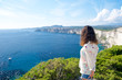 Beautiful girl admires the panorama of Bonifacio