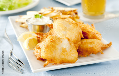 Closeup of fish and chips with tartar sauce.