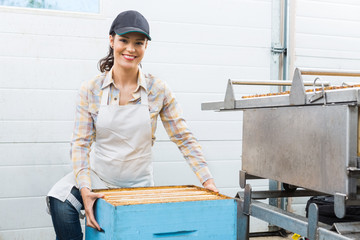 Female Beekeeper With Honeycomb Box At Factory