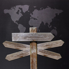 sign with world map with many directions to travel