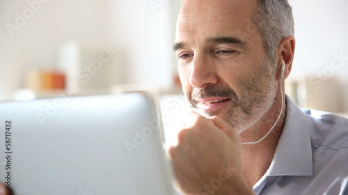 Businessman talking via internet with tablet