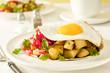 fried rosemary potatoes, egg, salsa and cilantro