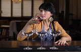 Young woman drinking alone at a bar