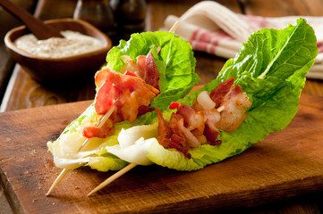 Bacon and romaine salad skewers with blue cheese dressing.