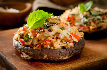mushrooms stuffed with rice, tomato, basil and mozzarella cheese