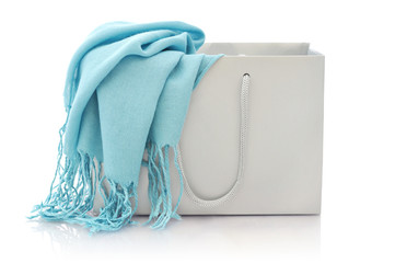 Blue scarf in shopping bag