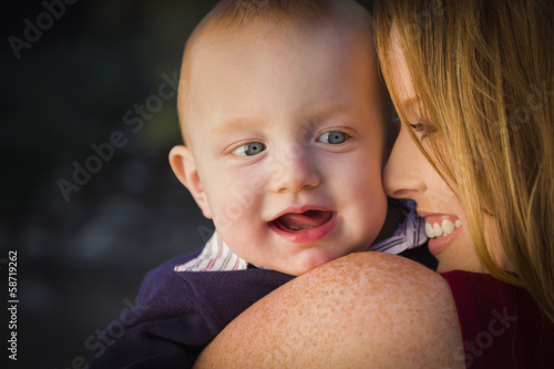 Cute Red Head Infant Boy Portrait with His Mother