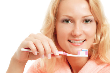 A young woman brushing teeth, closeup