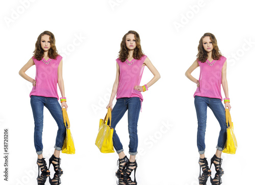 beautiful girl in jeans with yellow bag posing