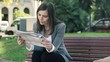 Businesswoman drinking coffee and reading newspaper in the city