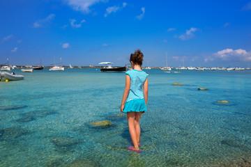 Kid girl walking at Formetera in Estany des Peix
