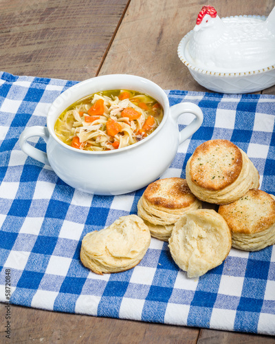 Chicken soup and biscuits on table