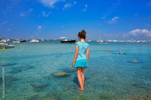 Kid girl walking at Formetera in Estany des Peix