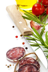 traditional sliced meat sausage salami and vegetables