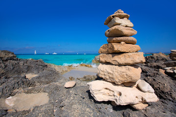 Stone figures on beach shore of Illetes beach in Formentera