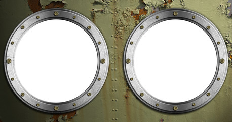 Two Metal Portholes on Green Background