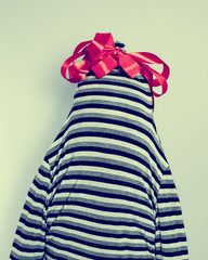 striped dress with a bow on her head