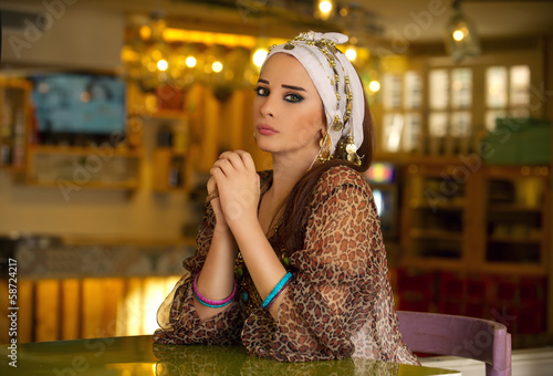 Arabian woman sitting in a cafe