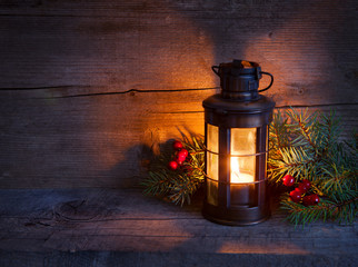 Cristmas lantern  in night on old wooden background.