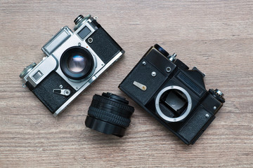 two vintage photo camera and lens
