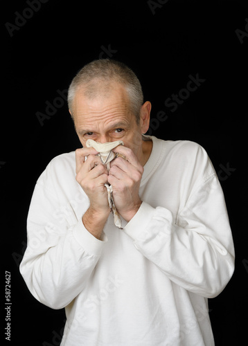 Sick Man with Cold holding handkerchief