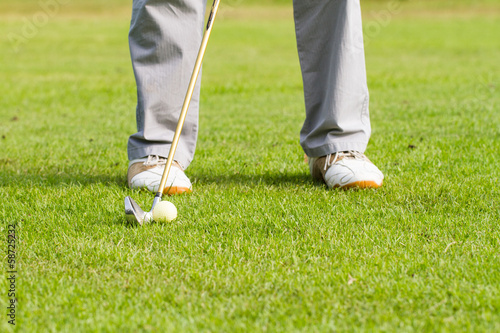 golfer on putting gesture