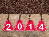 2014 text and coffee beans on a old burlap background