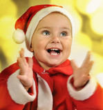 Christmas portrait of a child clapping hands