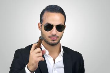 Young Caucasian man smoking cigar