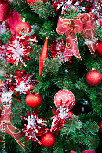 Christmas red balls and decorations on Christmas tree