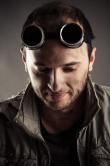 portrait of a nice man in welding goggles