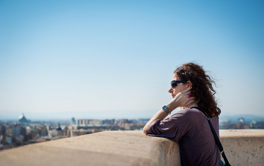 Tourist looking at the roofs of Valencia, Spain, from top of the
