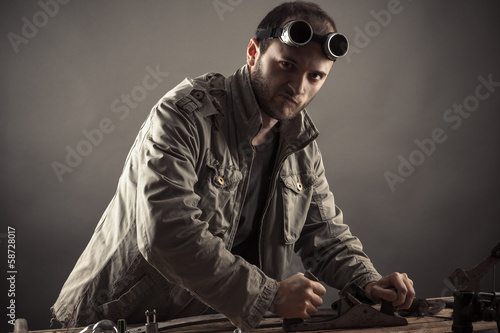 engineer working for a workbench in the workshop