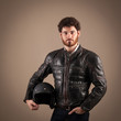 Confident young man portrait with leather jacket and helmet