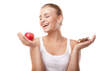 Woman holding apple and chocolate isolated