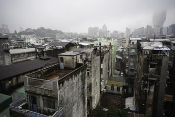 Old apartment blocks Macau China on a rainy day