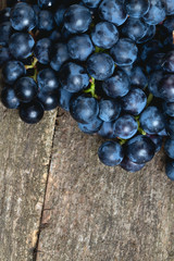 blue grapes on wooden surface