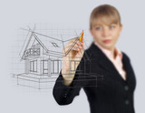 Woman drawing house on screen