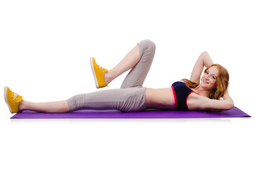 Young sporty woman doing exercises on white