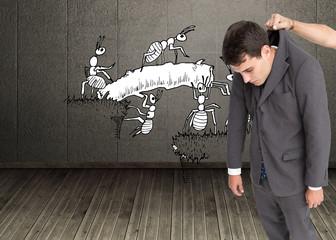 Composite image of businessman hanging