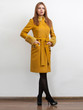 Sexy elegant woman wearing classic yellow coat with belt