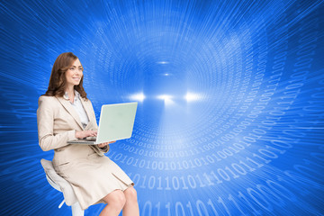 Composite image of smiling businesswoman sitting and using lapto
