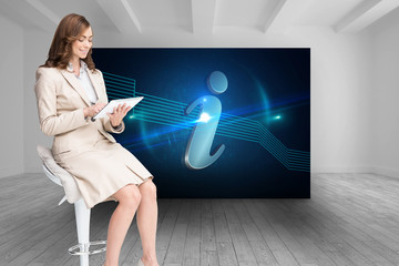 Composite image of happy businesswoman using tablet