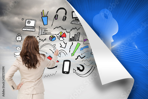 Composite image of businesswoman standing back to camera writing