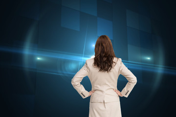 Composite image of businesswoman standing back to camera