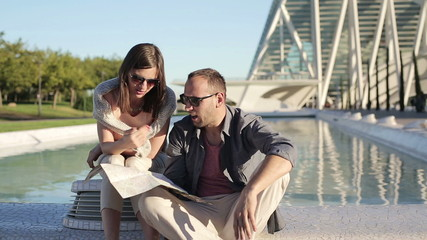Lost couple fighting over map in the city
