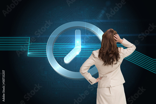Composite image of businesswoman standing back to camera with ha