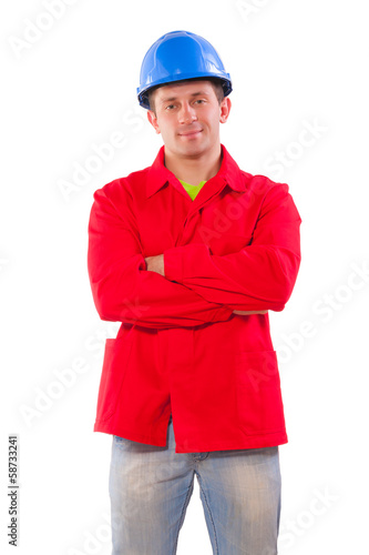 Happy builder with crossed hands isolated on white