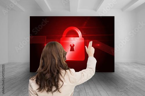 Composite image of brunette businesswoman standing back to camer